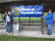 Friends of Raystown Lake members hang a banner to celebrate Lake Cleanup Day.