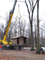 Maintenance employees install a new restroom in Susquehannock Campground near site 34.